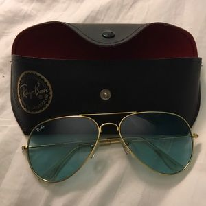 Light blue RayBans with gold trim